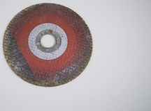 Grinding disc on a gray background with empty space to fill. Grinding disc on a gray background with empty space for text stock photos