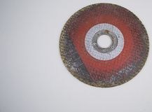 Grinding disc on a gray background with empty space to fill stock photography