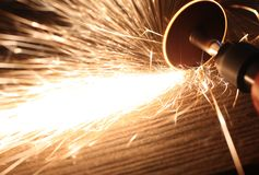 Grinding Disc and Sparks. Photo of a grinding disc on metal creating sparks Stock Images
