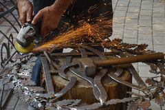 Grinding forged products. Royalty Free Stock Images