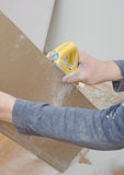 Grinding gypsum for smoothing surface Stock Photos