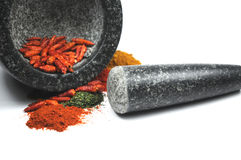 Grinding herbs and spices. Some herbs and spices in a mortar Stock Image