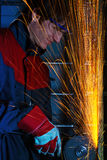 Grinding iron. Worker in safety glasses grinding iron Royalty Free Stock Photography