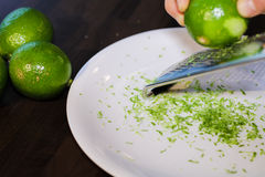 Grinding lime zest Stock Image