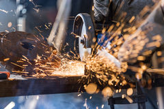 Grinding machine in action with bright sparks. Royalty Free Stock Images