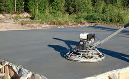 Grinding machine in action. Finish wet concrete Stock Images