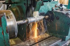 Grinding on the machine, high-precision machining of parts with an abrasive wheel on a circular grinding machine with cooling.  royalty free stock image