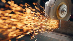 Grinding machine tool being used to cut metal. Someone using grinder to cut metal, sparks. Close up stock video