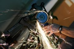 Grinding machine in use. Angle grinder , reconstruction of home concept , plumbing concept Stock Photography