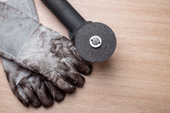 Grinding machine with used gloves Royalty Free Stock Photo
