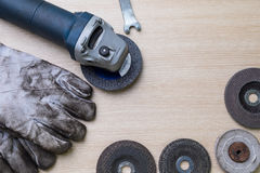 Grinding machine with used gloves Stock Images