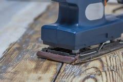 Grinding machine on wood Royalty Free Stock Image