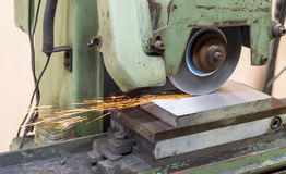 Grinding machine on work and spark. Close up grinding machine on work and spark Stock Photography