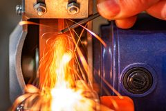 Grinding machine on work and spark with hand stock photography