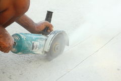 Grinding machine. Worker use grinding machine cutting concrete royalty free stock images