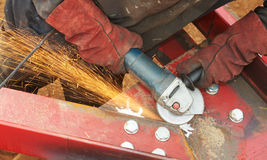 Grinding machine works with sparks Royalty Free Stock Photo