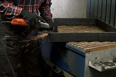 Grinding, man grinding metal, sparks flying from under the grinding wheel. Royalty Free Stock Photo