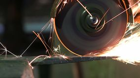 Grinding of metal part with circular saw stock video footage