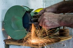 Grinding of metal parts. Simple locksmith works and repairs at t royalty free stock photos