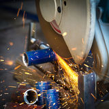 Grinding a metal plate. Worker grinding a metal plate Royalty Free Stock Images