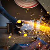 Grinding a metal plate Royalty Free Stock Images