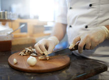 Grinding  mushrooms with knife Royalty Free Stock Photography