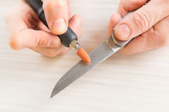 Grinding an old knife with rotary grindstone Royalty Free Stock Photos