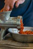 Grinding paprika for Ajvar royalty free stock photos