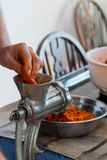 Grinding paprika for Ajvar royalty free stock images