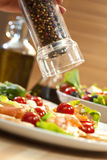 Grinding Pepper onto Seafood Salad Royalty Free Stock Image