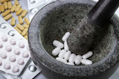 Grinding pills Stock Photo