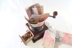 Grinding pounds into pennies Royalty Free Stock Photos