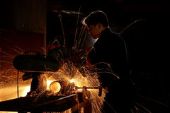 Grinding sparks. Sparks during working with steel in the factory Royalty Free Stock Photo