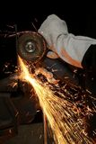 Grinding Sparks - Industry. Shower of orange sparks from a worker grinding steel Royalty Free Stock Photography