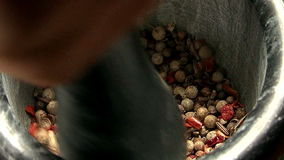 Grinding spices in a mortar stock footage