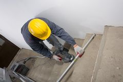 Grinding of stairs, grinding of concrete and checking levelness Royalty Free Stock Image