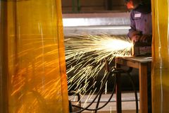 Grinding Steel. Worker grinding on steel Royalty Free Stock Image