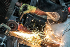 Grinding steel as sparks fly Stock Photos