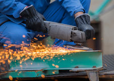 Grinding steel by electric grinding machine Royalty Free Stock Image