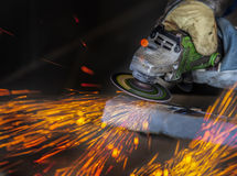 Grinding in a steel factory. Sparks while grinding in a steel factory stock image