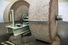 Grinding stone in olive oil factory Royalty Free Stock Photography