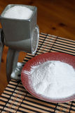 Grinding of sugar to the powder. Stock Photos