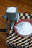 Grinding of sugar to the powder. Royalty Free Stock Photos
