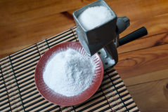 Grinding of sugar to the powder. Royalty Free Stock Images