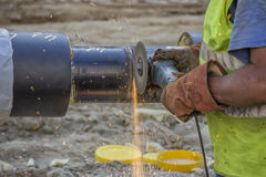 Grinding weld on a pipe segments Stock Images