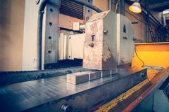 A grinding wheel produces metal scrap on the machine. stock image