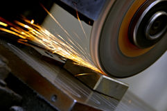 Grinding wheel and sparks Stock Photography