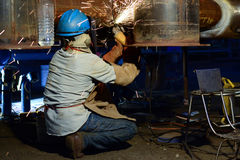 Grinding work. In the night time Stock Photography