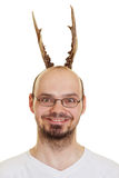 Grining man with antlers Royalty Free Stock Images