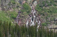 Grinnell Falls Tumble Over Montana Mountains stock photography